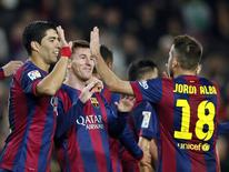 Barcelona's Lionel Messi (C), Luis Suarez (L) and Jordi Alba celebrate a goal against Cordoba during their Spanish First division soccer match at Camp Nou stadium in Barcelona December 20, 2014. REUTERS/Albert Gea