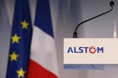 French and European flags are seen during an inaugural visit of the Alstom offshore wind turbine plants in Montoir-de-Bretagne, near Saint-Nazaire, western France, in this file photo taken December 2, 2014.  The French firm Alstom SA has pleaded guilty and will pay $772 million in criminal penalties to settle charges with the U.S. Justice Department alleging the company bribed government officials to win business in Indonesia, India and China. REUTERS/Stephane Mahe/Files