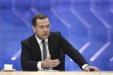 Russian Prime Minister Dmitry Medvedev speaks during a televised interview with Russian media in Moscow, December 10, 2014. REUTERS/Dmitry Astakhov/RIA Novosti/Pool
