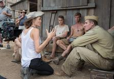 Director Angelina Jolie and Garrett Hedlund as Commander John Fitzgerald on the set of Unbroken. REUTERS/Universal Studios