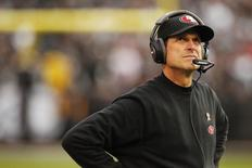 Dec 7, 2014; Oakland, CA, USA; San Francisco 49ers head coach Jim Harbaugh looks towards the scoreboard during a break in the action against the Oakland Raiders in the fourth quarter at O.co Coliseum. The Raiders defeated the 49ers 24-13. Mandatory Credit: Cary Edmondson-USA TODAY Sports
