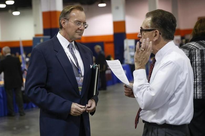 A man speaks with a job recruiter at the Nassau County Mega Job Fair at Nassau Veterans Memorial Coliseum in Uniondale, New York October 7, 2014.  REUTERS/Shannon Stapleton
