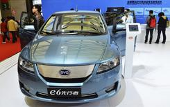 Customers take a look at an E6 electric car at a BYD dealership in Hangzhou, Zhejiang province December 18, 2014. REUTERS/China Daily