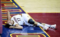 Cleveland Cavaliers center Anderson Varejao (17) reacts after suffering a leg injury in the third quarter against the Minnesota Timberwolves at Quicken Loans Arena. David Richard-USA TODAY Sports