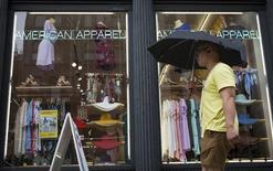 A man walks past an American Apparel store in New York June 19, 2014.  REUTERS/Brendan McDermid