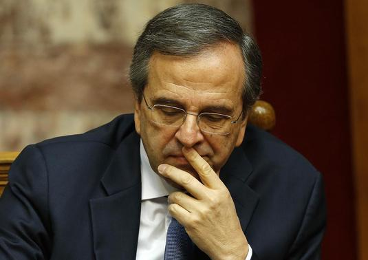 Greek Prime Minister Antonis Samaras reacts in parliament during the last round of a presidential vote in Athens December 29, 2014. REUTERS-Yannis Behrakis