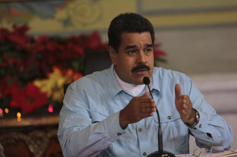 Venezuela's President Nicolas Maduro speaks during a meeting with governors and ministers at Miraflores Palace in Caracas in this handout photo provided by Miraflores Palace December 22, 2014. REUTERS/Miraflores Palace/Handout via Reuters