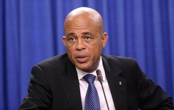Haitian President Michel Martelly addresses a media conference at the Diplomatic Centre in St Ann's, on the outskirts of the capital Port-of-Spain, November 26, 2013. REUTERS/Andrea De Silva
