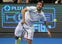 Marin Cilic makes a serve to Gael Monfils of the Indian Aces during their men's single match at the International Premier Tennis League (IPTL) in Manila November 30, 2014. REUTERS/Romeo Ranoco