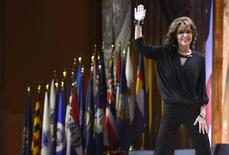 Former Alaska Governor Sarah Palin waves as she departs the stage after remarks to the Conservative Political Action Conference (CPAC) in Oxon Hill, Maryland, March 8, 2014.    REUTERS/Mike Theiler