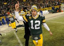 Green Bay Packers quarterback Aaron Rodgers (12) reacts after the Packers beat the Detroit Lions 30-20 at Lambeau Field. Benny Sieu-USA TODAY Sports