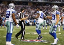 Dallas Cowboys wide receiver Dez Bryant (88) argues a pass interference call with side judge Allen Baynes (56) that was called on linebacker Anthony Hitchens (59) in the fourth quarter against the Detroit Lions in the NFC Wild Card Playoff Game at AT&T Stadium.  Tim Heitman-USA TODAY Sports