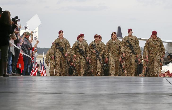 Paratroopers with the 1st Brigade Combat Team, 82nd Airborne Division, march up the ramp as they return home from Afghanistan at Pope Army Airfield in Fort Bragg, North Carolina November 5, 2014. REUTERS/Chris Keane