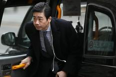 Samin Tan, chairman of Bumi Plc arrives before a shareholder meeting in London February 21, 2013.  REUTERS/Stefan Wermuth