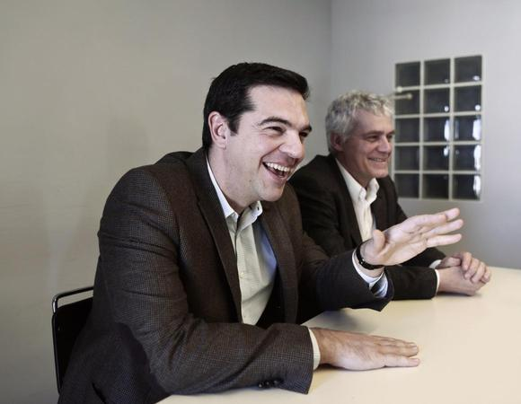 Alexis Tsipras (L), opposition leader and head of radical leftist Syriza party, smiles during a meeting with members of the Greens-Ecologists party, at the party's headquarters in Athens January 7, 2015. REUTERS/Alkis Konstantinidis