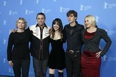 """Producer Cathleen Sutherland, director, screenwriter and producer Richard Linklater and cast members Lorelei Linklater, Ellar Coltrane and Patricia Arquette (L-R) pose during a photocall to promote the movie """"Boyhood"""" during the 64th Berlinale International Film Festival in Berlin February 13, 2014.  REUTERS/Tobias Schwarz"""