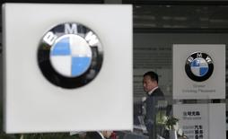 A customer waits to pay for a car at a BMW dealership in Wuhan, Hubei province, October 23, 2012. REUTERS/Stringer