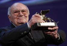Italian director Francesco Rosi holds the Golden Lion Lifetime Achievement award at the 69th Venice Film Festival August 31, 2012. REUTERS/Tony Gentile