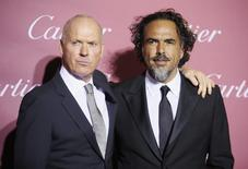 "Director Alejandro Gonzalez Inarritu (R), who is receiving the Director of the Year Award, and Michael Keaton, from the film ""Birdman,"" pose at the 26th Annual Palm Springs International Film Festival Awards Gala in Palm Springs, California, January 3, 2015. REUTERS/Danny Moloshok"