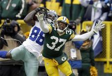 Jan 11, 2015; Green Bay, WI, USA; Dallas Cowboys wide receiver Dez Bryant (88) is unable to make a catch against Green Bay Packers cornerback Sam Shields (37) in the fourth quarter in the 2014 NFC Divisional playoff football game at Lambeau Field. Mandatory Credit: Jeff Hanisch-USA TODAY Sports