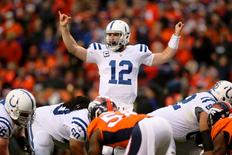 Jan 11, 2015; Denver, CO, USA; Indianapolis Colts quarterback Andrew Luck (12) gestures before a snap against the Denver Broncos during the second quarter in the 2014 AFC Divisional playoff football game at Sports Authority Field at Mile High. Mandatory Credit: Mark J. Rebilas-USA TODAY Sports