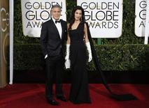 Actor George Clooney and his wife Amal Clooney arrive at the 72nd Golden Globe Awards in Beverly Hills, California January 11, 2015.   REUTERS/Mario Anzuoni