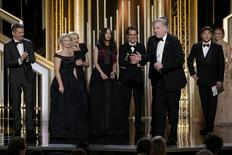 """Producer Jonathan Sehring (3rd R) accepts the Golden Globe Award for Best Motion Picture - Drama for """"Boyhood"""" at the 72nd Golden Globe Awards.  REUTERS/Paul Drinkwater/NBC"""