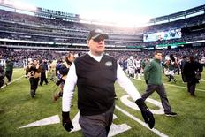 Dec 21, 2014; East Rutherford, NJ, USA; New York Jets head coach Rex Ryan walks off the field after losing to the New England Patriots at MetLife Stadium. The Patriots defeated the Jets 17-16. Mandatory Credit: Brad Penner-USA TODAY Sports