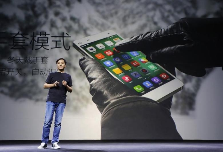 Lei Jun, founder and chief executive officer of China's mobile company Xiaomi Inc, introduces the new features of Xiaomi Phone 4 at its launching ceremony, in Beijing, July 22, 2014. REUTERS/Jason Lee