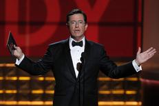 Presenter Stephen Colbert takes the stage to hand out the award for outstanding lead actress in a comedy series at the 64th Primetime Emmy Awards in Los Angeles, in this September 23, 2012 file photo.   REUTERS/Lucy Nicholson