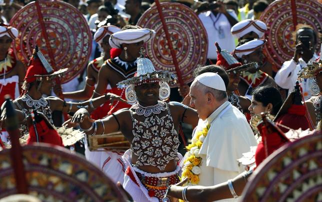 Pope Francis is greeted as he arrives at the Colombo airport January 13, 2015. REUTERS/Stefano Rellandini