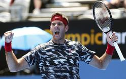 Argentina's Juan Martin Del Potro reacts after defeating Ukraine's Sergiy Stakhovsky in their first round match at the Sydney International tennis tournament at Sydney Olympic Park January 13, 2015. REUTERS/Rick Stevens