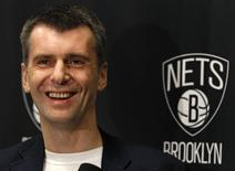 Brooklyn Nets owner Mikhail Prokhorov smiles during an interview before the Nets take on the Minnesota Timberwolves in their NBA basketball game in New York November 5, 2012. REUTERS/Adam Hunger