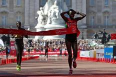 Edna Kiplagat of Kenya crosses the finish line followed by compatriot Florence Kiplagat to win the women's Elite London Marathon April 13, 2014.      REUTERS/Eddie Keogh