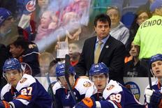 New York Islanders head coach Jack Capuano coaches against the Montreal Canadiens during the first period at Nassau Veterans Memorial Coliseum. Mandatory Credit: Brad Penner-USA TODAY Sports
