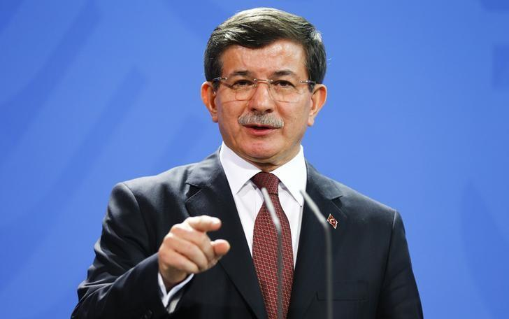 Turkish Prime Minister Ahmet Davutoglu speaks to media after his meeting with German Chancellor Angela Merkel at the Chancellery in Berlin, January 12, 2015.         REUTERS/Hannibal Hanschke