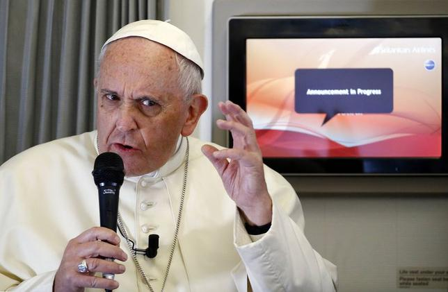 Pope Francis gestures as he answers questions from a journalist during the flight from Colombo, Sri Lanka, to Manila in the Philippines January 15, 2015. REUTERS/ Stefano Rellandini