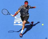 Argentina's Juan Martin Del Potro reaches for a shot during his quarter-final match against Kazakhstan's Mikhail Kukushkin at the Sydney International tennis tournament at Sydney Olympic Park January 15, 2015. REUTERS/Rick Stevens