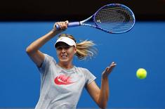 Russia's Maria Sharapova hits a shot during a practice session on Rod Laver Arena at Melbourne Park January 15, 2015. REUTERS/David Gray