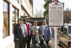Friendship Nine members Clarence Graham, David Williamson Jr., Willie Thomas Massey, James F. Wells and Willie E. McCleod (L-R) stand in front of a historical commemorative marker outside the Five & Dine diner in Rock Hill, South Carolina, December 17, 2014.  REUTERS/Jason Miczek