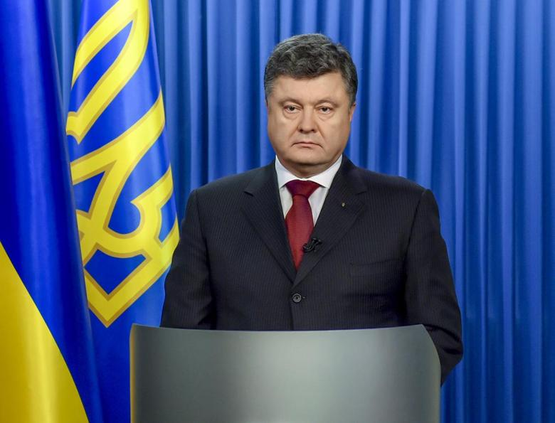 Ukraine's President Petro Poroshenko is seen as he makes his address to the nation in Kiev, in this January 13, 2015 handout photo provided by the Ukrainian Presidential Press Service.  REUTERS/Ukrainian Presidential Press Service/Mykola Lazarenko/Handout via Reuters
