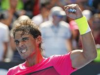 Rafael Nadal of Spain celebrates after defeating Mikhail Youzhny of Russia in their men's singles first round match at the Australian Open 2015 tennis tournament in Melbourne January 19, 2015.    REUTERS/Issei Kato