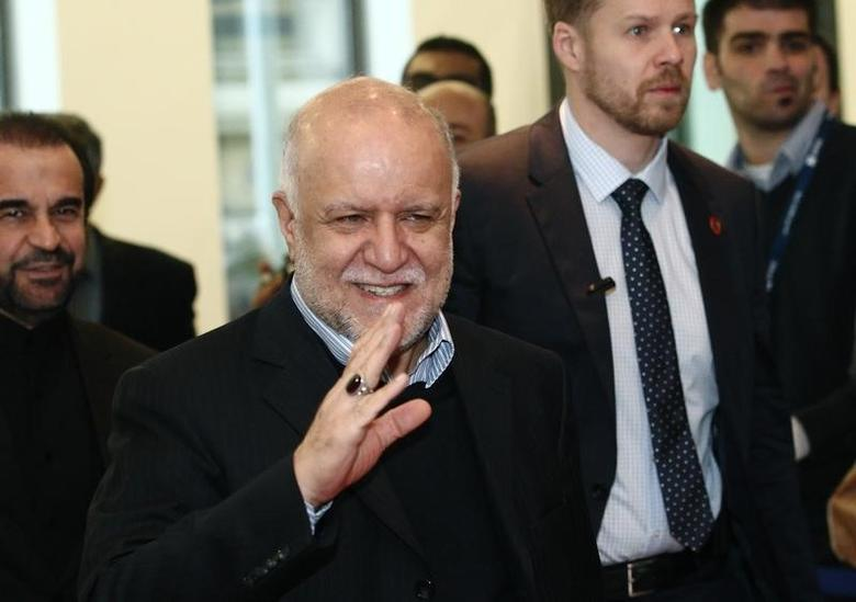 Iranian Oil Minister Bijan Zanganeh wave to journalists as he arrives for a meeting of OPEC oil ministers at OPEC's headquarters in Vienna December 4, 2013.  REUTERS/Heinz-Peter Bader