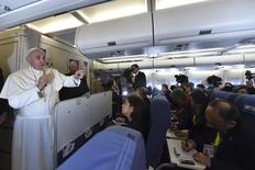 Pope Francis gestures as he speaks with journalists on his flight back from Manila to Rome, January 19, 2015.  REUTERS/Giuseppe Cacace