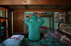Pooja Bohara, a rape victim, poses for a picture inside her room at the Raksha Nepal rehabilitation centre in Kathmandu January 16, 2015.     REUTERS/Navesh Chitrakar