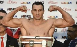 Ukrainian WBA, WBO, IBO and IBF heavyweight boxing world champion Vladimir Klitschko clenches his fists during the official weighing in Hamburg on November 14, 2014. REUTERS/Fabian Bimmer