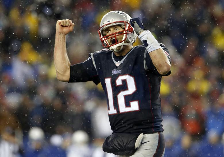 Jan 18, 2015; Foxborough, MA, USA; New England Patriots quarterback Tom Brady (12) pumps his fists as he heads to the sideline in the fourth quarter against the Indianapolis Colts the AFC Championship Game at Gillette Stadium.  David Butler II-USA TODAY Sports