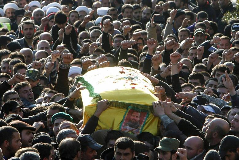 Hezbollah members and supporters carry the coffin of Lebanon's Hezbollah commander Mohamad Issa, known as Abu Issa, during his funeral in Arab-Salim, south Lebanon January 20, 2015. REUTERS/Ali Hashisho
