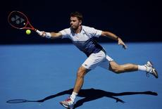 Stan Wawrinka of Switzerland hits a return to Marius Copil of Romania during their men's singles second round match at the Australian Open 2015 tennis tournament in Melbourne January 22, 2015. REUTERS/Athit Perawongmetha