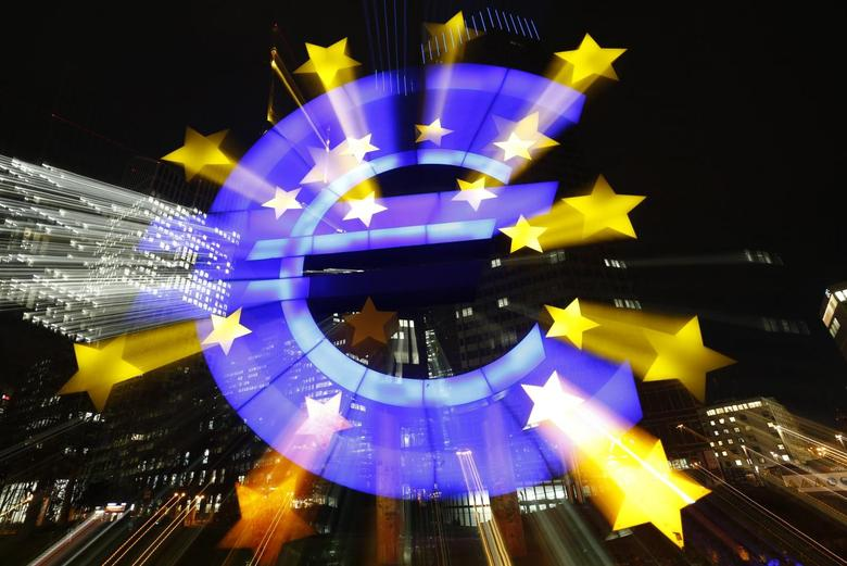The famous euro sign landmark is photographed outside the former head quarters of the European Central Bank (ECB) in Frankfurt, late evening January 20, 2015. REUTERS/Kai Pfaffenbach